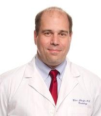Dr. Skoufis