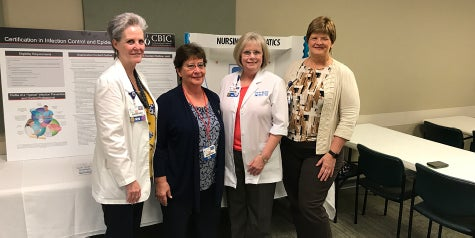 Four nurses gather from Baptist Health Care to honor other nurses for their achievements.