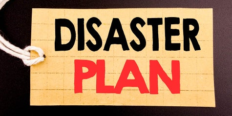 Words say disaster plan on a piece of paper