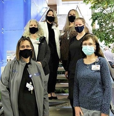 Microbiology team pictured wearing masks