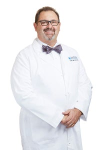 Dr. Lauro wearing white coat and bow tie