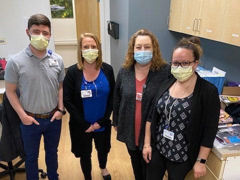 Baptist Medical Park - Navarre registration team members pose for camera.