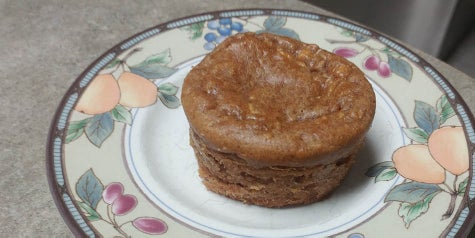 Peanut butter and apple flavored muffin on a serving plate