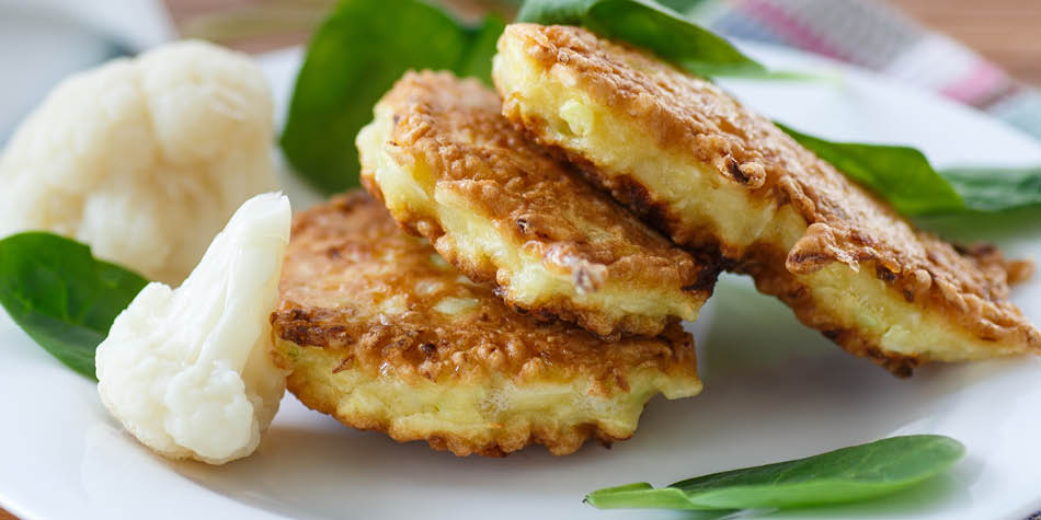 Cauliflower fritters served on a plate