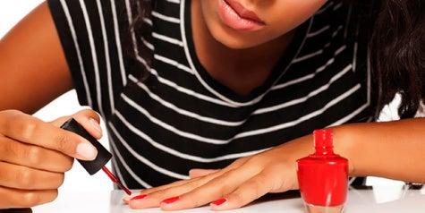 Painting finger nails with nail polish