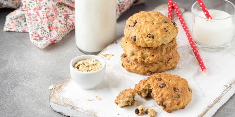 banana oatmeal chocolate chip cookies on a tray with milk