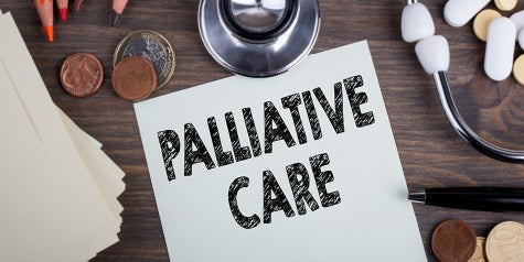 The words Palliative Care are written and surrounded by office supplies and medical equipment