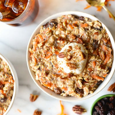 Overnight Oats with carrots, walnuts and raisins in a bowl