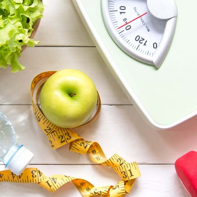 Scales, tape measure, apple and bottle of water