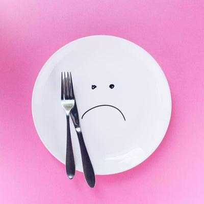 drawing of unhappy face on plate
