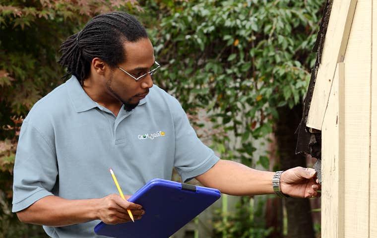 technician inspecting exterior in alpharetta georgia
