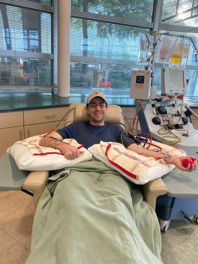 William is all smiles as he donates blood stem cells.