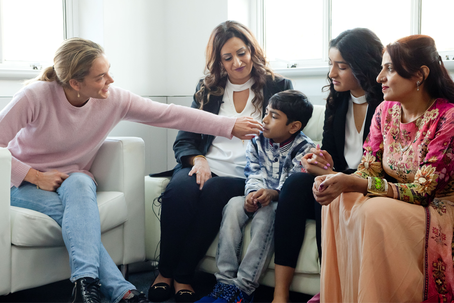 Katharina Harf meeting with a patient and their family