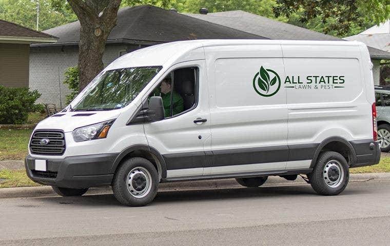 all states lawn and pest company van with driver in front seat