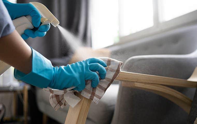 person wiping furniture in durham north carolina