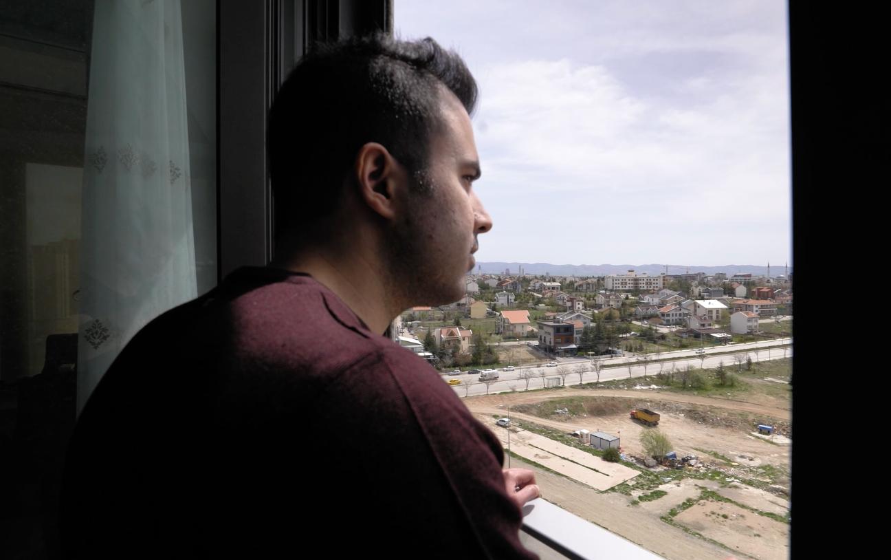 Berk Arslan looking out a window