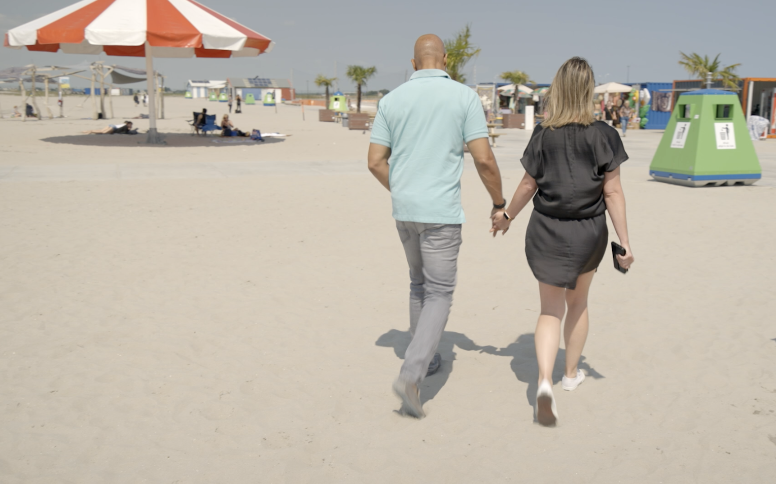 Andres Ramirez Walking on the Beach with his Girlfriend