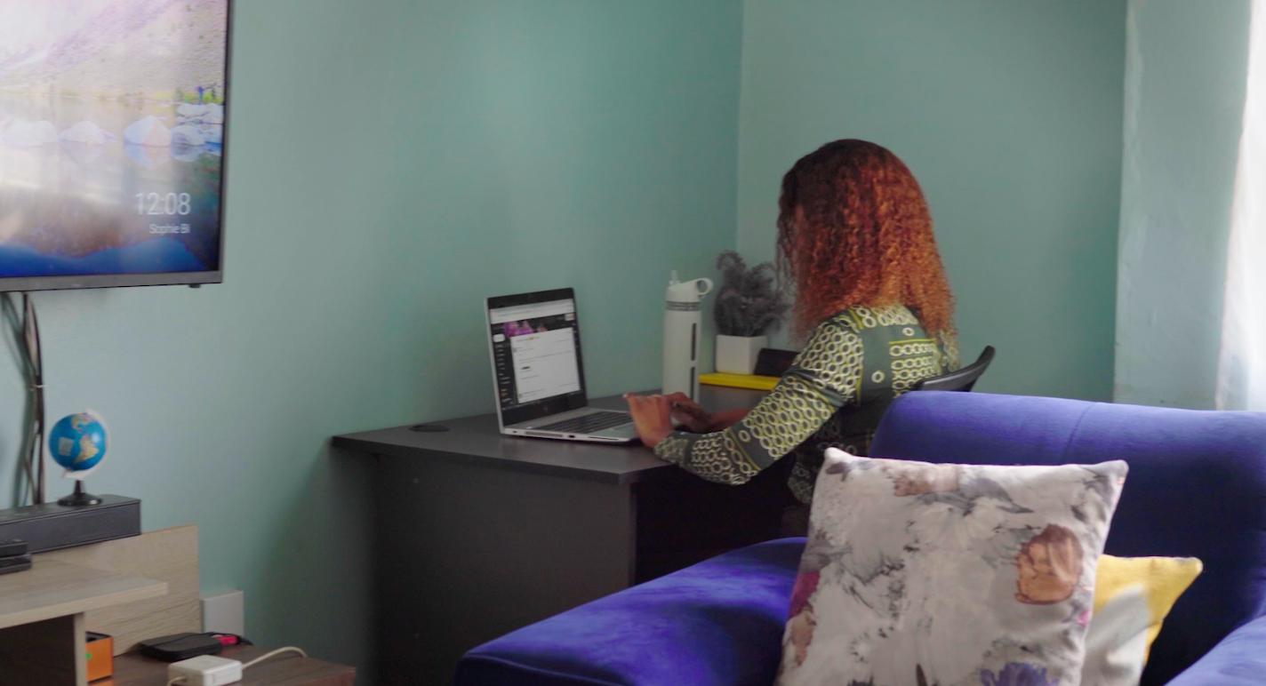 Faith Sila working at a desk