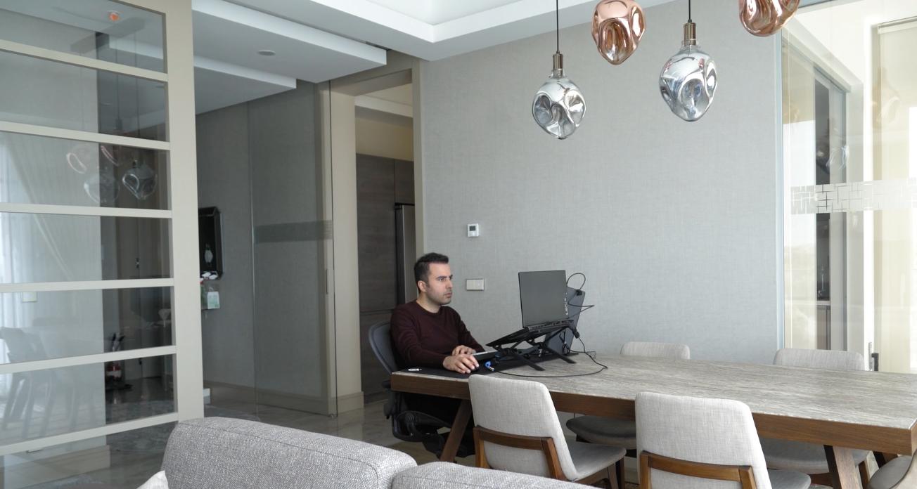 Berk Arslan working at his table