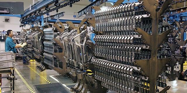 PPG employee monitoring streamline coating system at regional coating centre.