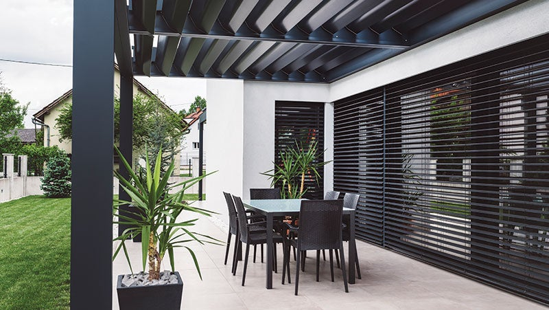 A residential house with a black veranda that has been coated with PPG's ENVIROCRON® PCS P4 Series to produce a matte finish.