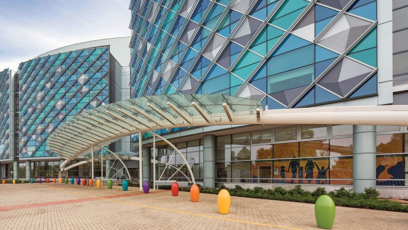 """The colorful entrance of Nemours Hospital for Children uses PPG's Duranar XL coatings in """"Seafoam Green"""" to finish the metal panels."""