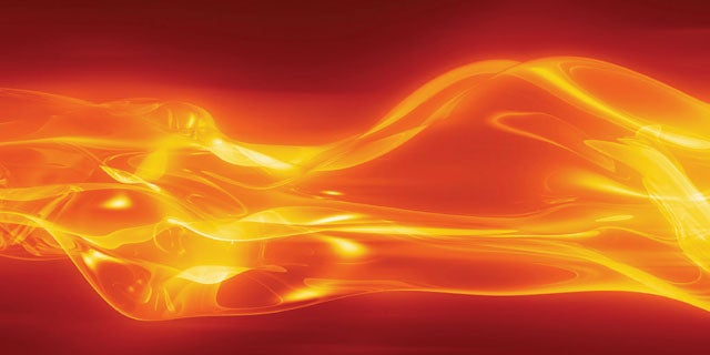 Hot metal substrate being cured creating a fiery orange flowing glow of light.