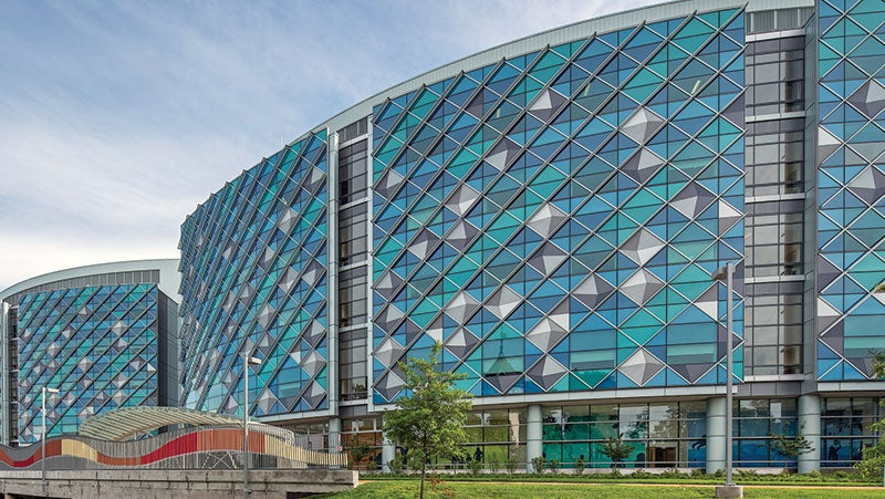 Exterior of Nemours Hospital for Children in Wilmington, Delaware, showing the building's signature blue and green, glass and metal façade.