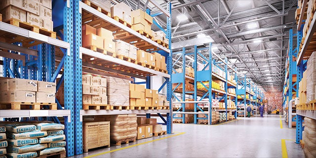 A large warehouse with tall shelving containing inventory.