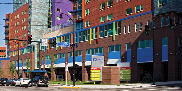 Exterior of Children's Hospital of Pittsburgh showing colorful coatings used in blue, green, orange, yellow and purple.