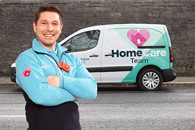 Boiler Service Engineer standing in front of HomeCare Team van on a street