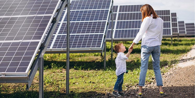 Woman and child by solar panels