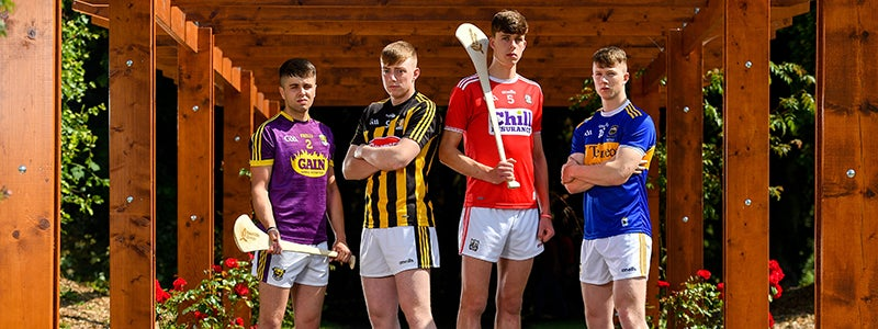 4 hurling players standing