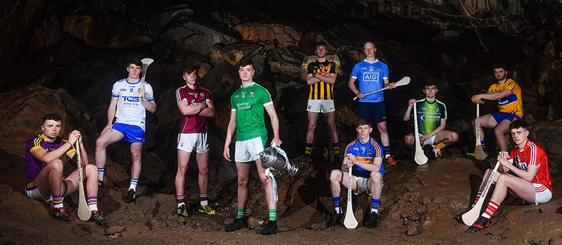 GAA hurlers standing in a cave