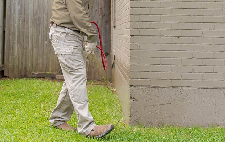 spray treatment outside a house