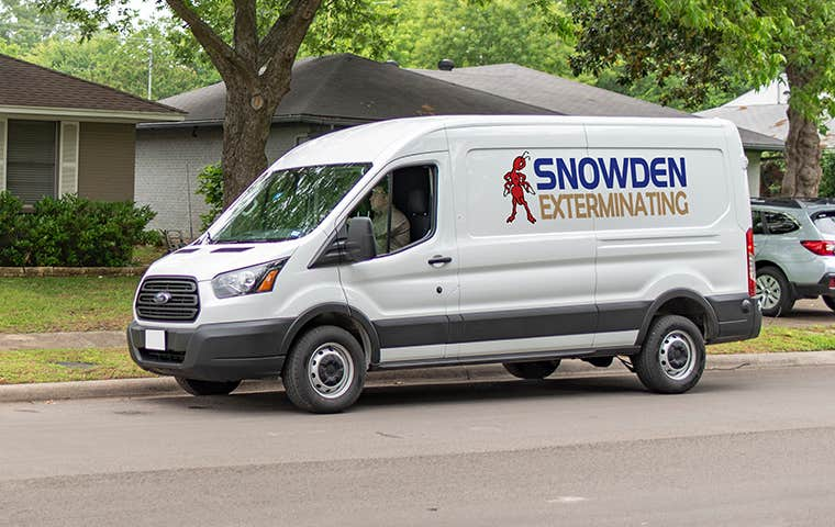 a company van in front of houses