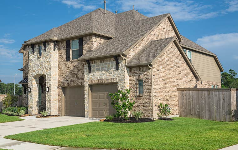 street view of a brick home in the woodlands texas