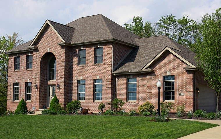 a brick three story house
