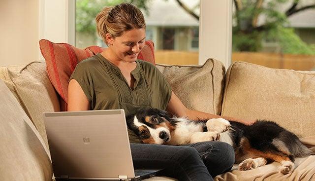 1a-woman-holding-dog-Gal-750 x 562