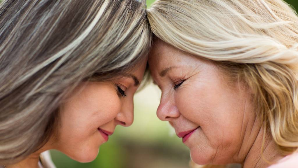 mother and daughter sharing deep comforting moment