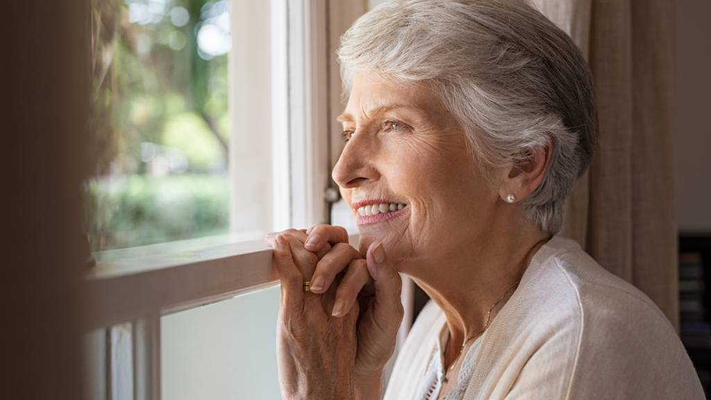 woman thinking about cremation or burial