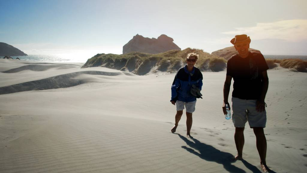 retired couple on beach in New Zealand