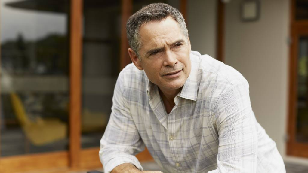 man thinking about funeral insurance questions