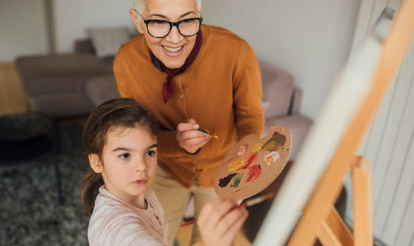 grandmother and grandkids painting together
