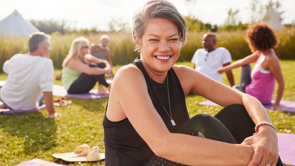 woman exercising with group