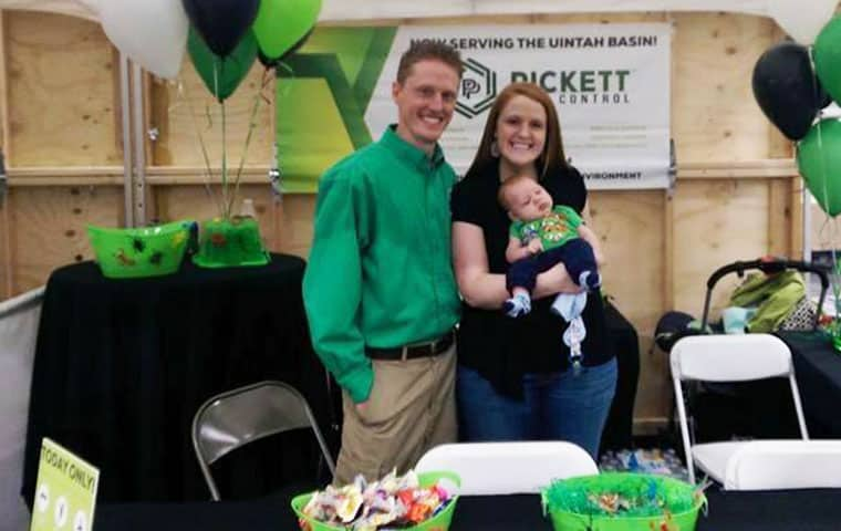 bryce pickett with his wife and child