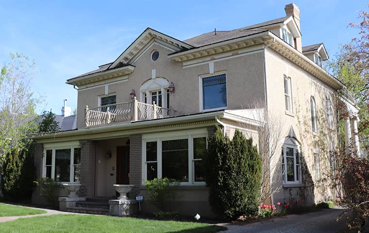 very nice home with ornate balcony on second floor