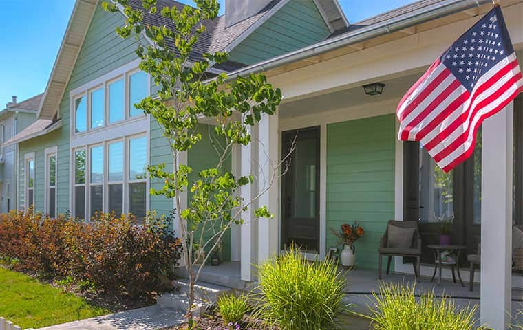 nice home in Maeser Utah with American flag out front