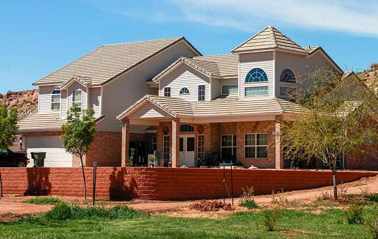 nice home in Vernal Utah with red brick wall surrounding yard