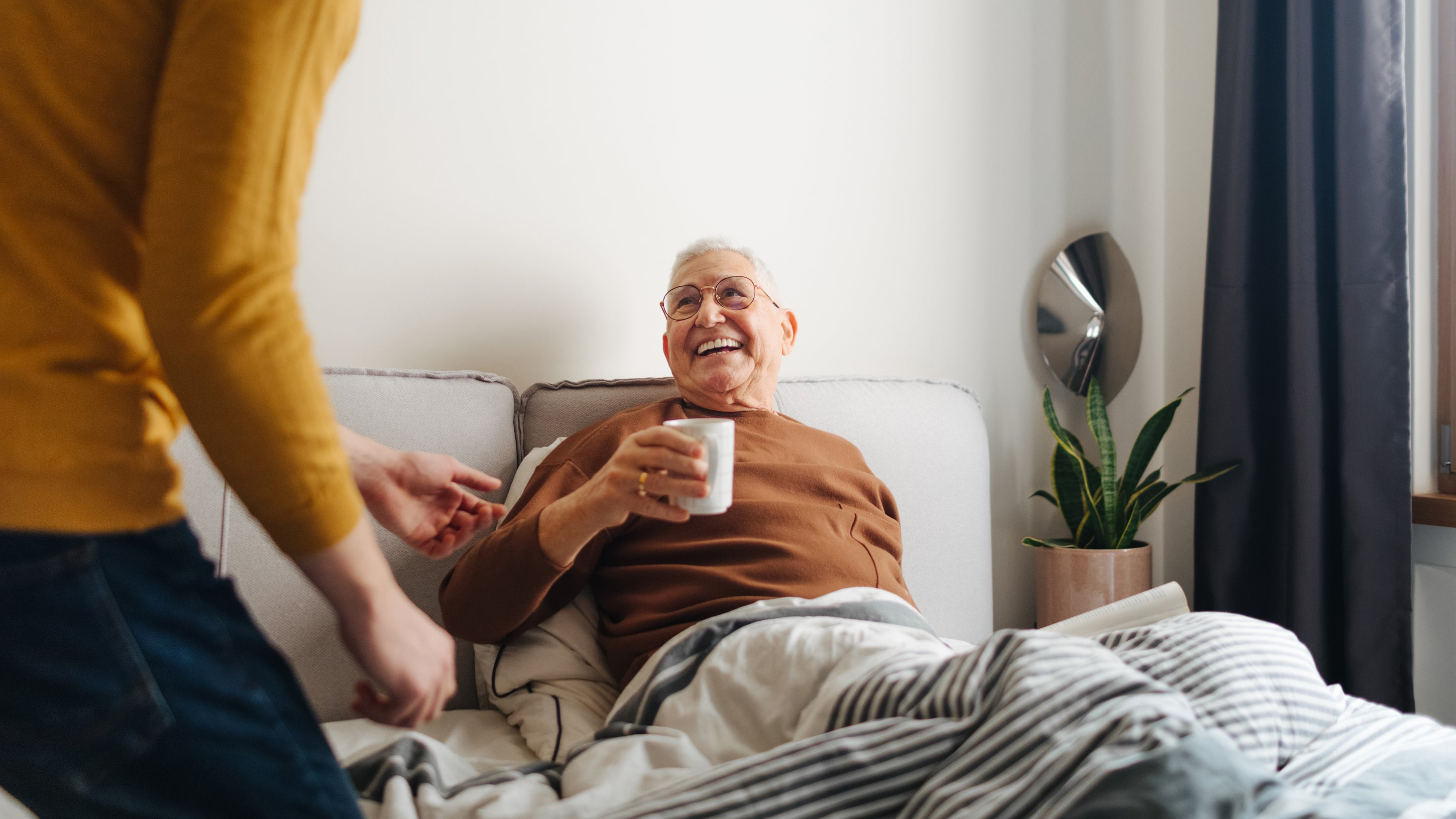 <p>Young man caring for grandfather</p>